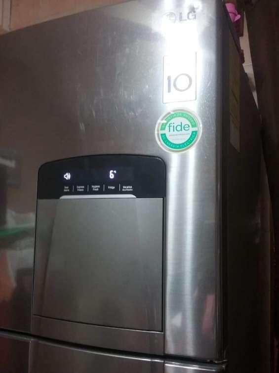 Vendo refrigerador lg barato y bien cuidado con dispensador para agua y hielos